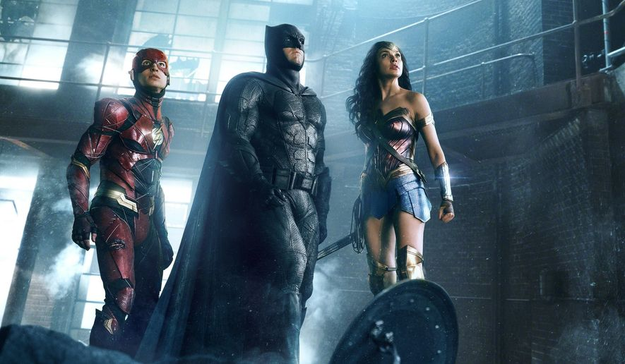 """This image released by Warner Bros. Pictures shows Ezra Miller, from left, Ben Affleck and Gal Gadot in a scene from """"Justice League."""" (Warner Bros. Entertainment Inc. via AP)"""