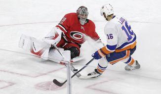 Carolina Hurricanes goalie Cam Ward blocks New York Islanders' Andrew Ladd (16) during the third period of an NHL hockey game in Raleigh, N.C., Sunday, Nov. 19, 2017. Carolina won 4-2. (AP Photo/Gerry Broome)