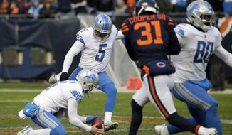 Detroit Lions kicker Matt Prater (5) kicks a 52-yard field goal during the second half of an NFL football game against the Chicago Bears, Sunday, Nov. 19, 2017, in Chicago. (AP Photo/Nam Y. Huh)