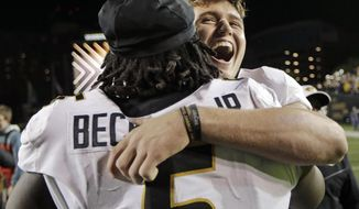 Missouri quarterback Drew Lock hugs defensive lineman Terry Beckner Jr. (5) after Missouri defeated Vanderbilt 45-17 in an NCAA college football game Saturday, Nov. 18, 2017, in Nashville, Tenn. (AP Photo/Mark Humphrey)