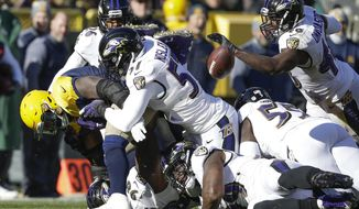 Green Bay Packers' Devante Mays fumbles the ball during the first half of an NFL football game against the Baltimore Ravens Sunday, Nov. 19, 2017, in Green Bay, Wis. The Ravens recovered the ball. (AP Photo/Jeffrey Phelps)