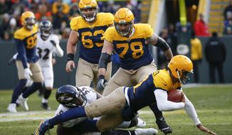 Green Bay Packers quarterback Brett Hundley is sacked by Baltimore Ravens' Terrell Suggs during the second half an NFL football game Sunday, Nov. 19, 2017, in Green Bay, Wis. The Ravens won 23-0. (AP Photo/Mike Roemer)