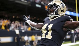 New Orleans Saints running back Alvin Kamara (41) celebrates his game-tying two-point conversion in the second half of an NFL football game against the Washington Redskins in New Orleans, Sunday, Nov. 19, 2017. The Saints won -34-31. (AP Photo/Rusty Costanza)
