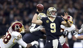 New Orleans Saints quarterback Drew Brees (9) drops back to pass under pressure from Washington Redskins linebacker Junior Galette (58) in the first half of an NFL football game in New Orleans, Sunday, Nov. 19, 2017. (AP Photo/Rusty Costanza) **FILE**