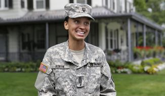 FILE - In this Monday, Aug. 14, 2017, file photo, Cadet Simone Askew, of Fairfax, Va., who has been selected first captain of the U.S. Military Academy Corps of Cadets for the upcoming academic year, answers questions during a news conference, in West Point, NY. Askew earned another prestigious honor Sunday, Nov. 19, when she was one of 32 Americans awarded Rhodes scholarships to study at Oxford University in England. (AP Photo/Richard Drew, File)