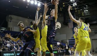 Saint Mary's 's Emmett Naar (3) drives to the basket against San Jose State during the second half of an NCAA college basketball game, Sunday, Nov. 19, 2017, in San Jose, Calif. (AP Photo/Marcio Jose Sanchez)