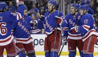 New York Rangers' Kevin Hayes, center, celebrates his goal with teammates during the second period of the NHL hockey game against the Ottawa Senators, Sunday, Nov. 19, 2017, in New York. (AP Photo/Seth Wenig)