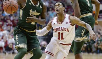 Indiana Hoosiers guard Devonte Green (11) defends South Florida Bulls guard Terrence Samuel (2) during the Indiana South Florida men's NCAA college basketball game at Simon Skjodt Assembly Hall in Bloomington, Ind., Sunday, Nov. 19, 2017. (Chris Howell/The Herald-Times via AP)