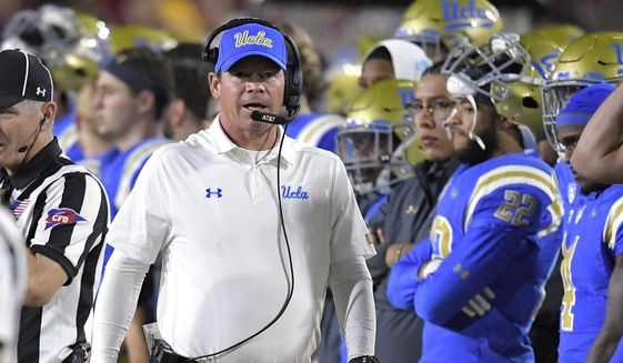 UCLA head coach Jim Mora walks the sideline during the first half of an NCAA college football game against Southern California, Saturday, Nov. 18, 2017, in Los Angeles. (AP Photo/Mark J. Terrill) **FILE**
