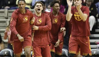 Southern California players celebrate after a score against Vanderbilt in overtime in an NCAA college basketball game, Sunday, Nov. 19, 2017, in Nashville, Tenn. USC won 93-89 in overtime. (AP Photo/Mark Humphrey)