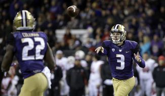 Washington quarterback Jake Browning (3) throws a pass to Lavon Coleman for a 6-yard touchdown against Utah during the first half of an NCAA college football game Saturday, Nov. 18, 2017, in Seattle. (AP Photo/Elaine Thompson)