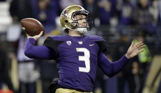 Washington quarterback Jake Browning drops back to pass against Utah during the first half of an NCAA college football game Saturday, Nov. 18, 2017, in Seattle. (AP Photo/Elaine Thompson)
