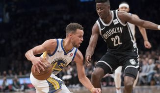 Golden State Warriors guard Stephen Curry (30) drives to the basket against Brooklyn Nets guard Caris LeVert (22) during the first half of an NBA basketball game, Sunday, Nov. 19, 2017, in New York. (AP Photo/Mary Altaffer)