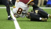 Redskins quarterback Kirk Cousins is sacked as The New Orleans Saints take on The Washington Redskins during an NFL football game in the Mercedes-Benz Superdome, Sunday, Nov. 19, 2017 in New Orleans.   (Scott Clause/The Daily Advertiser via AP)