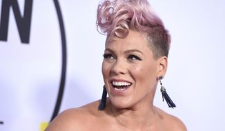 Pink arrives at the American Music Awards at the Microsoft Theater on Sunday, Nov. 19, 2017, in Los Angeles. (Photo by Jordan Strauss/Invision/AP)