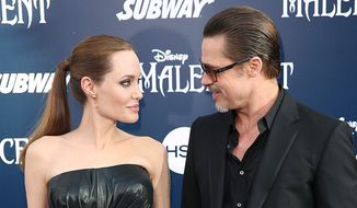"""Brad Pitt stated that he """"fell in love"""" with Angelina Jolie while filmingMr. and Mrs. Smith. Pitt was still married to Jennifer Aniston at the time. Jolie's former bodyguard claims that the romance started on the set of their 2005 film. (Associated Press) ** FILE **"""