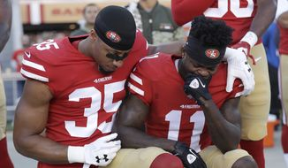 San Francisco 49ers safety Eric Reid (35) and wide receiver Marquise Goodwin (11) kneel during the performance of the national anthem before an NFL football game against the New York Giants in Santa Clara, Calif., Sunday, Nov. 12, 2017. (AP Photo/Marcio Jose Sanchez) **FILE**