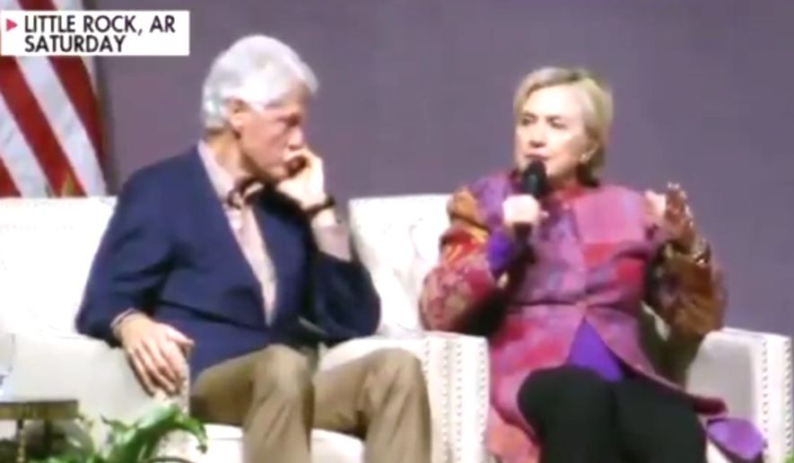 Former President Bill Clinton listens to Hillary Clinton discuss his tenure in the White House, Nov. 18, 2017. (Image: Fox News Channel screenshot)