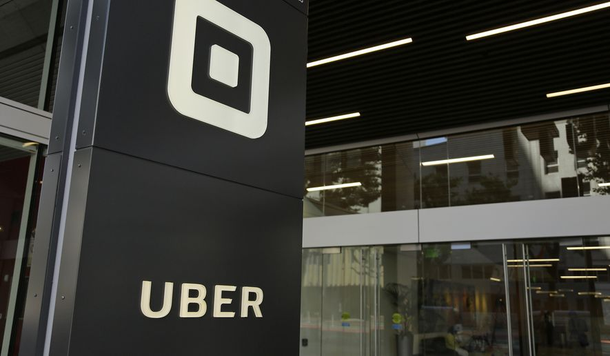 This June 21, 2017, file photo shows the building that houses the headquarters of Uber, in San Francisco. (AP Photo/Eric Risberg, File)