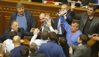 Ukrainian lawmakers scuffled during a parliament session in October. Former Georgian President Mikhail Saakashvili, who now heads an opposition party, accuses President Petro Poroshenko of stalling reforms and covering up corruption. (Associated Press/File)