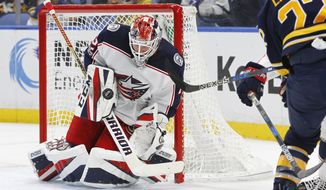 Buffalo Sabres' Johan Larsson (22) is stopped by Columbus Blue Jackets goalie Sergei Bobrovsky (72) during the first period of an NHL hockey game, Monday Nov. 20, 2017, in Buffalo, N.Y. (AP Photo/Jeffrey T. Barnes)