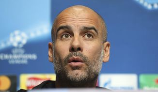Manchester City manager Pep Guardiola  speaks during a press conference at the City Football Academy,  in Manchester England Monday Nov. 20, 2017. City will play Feyenoord in a Champions League soccer match in Manchester  on Tuesday. (Martin Rickett/PA via AP)