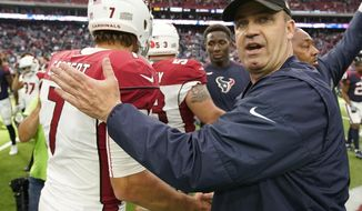 Houston Texans head coach Bill O'Brien, right, greets Arizona Cardinals quarterback Blaine Gabbert (7) following an NFL football game, Sunday, Nov. 19, 2017, in Houston. Houston won 31-21. (AP Photo/David J. Phillip)