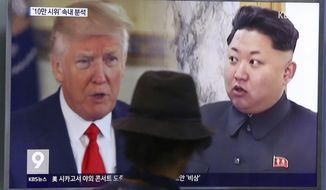 In this Aug. 10, 2017, file photo, a man watches a TV screen showing U.S. President Donald Trump and North Korean leader Kim Jong-un, right, during a news program at the Seoul Train Station in Seoul, South Korea. (AP Photo/Ahn Young-joon, File)