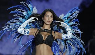 Model Bella Hadid wears a creation during the Victoria's Secret fashion show at the Mercedes-Benz Arena in Shanghai, China, Monday, Nov. 20, 2017. (AP Photo/Andy Wong)
