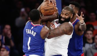 Los Angeles Clippers' Jawun Evans (1) and New York Knicks' Kyle O'Quinn (9) fight for control of the ball during the first half of an NBA basketball game Monday, Nov. 20, 2017, in New York. (AP Photo/Frank Franklin II)