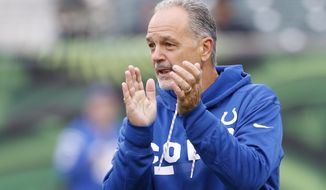 FILE - In this Oct. 29, 2017, file photo, Indianapolis Colts head coach Chuck Pagano works the field during practice before an NFL football game against the Cincinnati Bengals, in Cincinnati. Pagano eagerly returned to work Monday, Nov. 20, 2017. One reason for optimism in a mostly bleak season: A week off gave the Colts time to rest and recover. (AP Photo/Gary Landers, File)