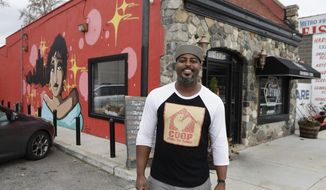 """In a photo from Friday, Nov. 17, 2017, River Bistro chef Maxcel Hardy stands outside his restaurant in Detroit. Hardy plans to open another restaurant, Coop Detroit, in January in Midtown. He is a Detroit native and has partnered with restaurants in places like Harlem and Miami. """"Detroit truly is a community and family-based,"""" he said. """"Everyone says it's a 'small big city.' For chefs, it's really hot. There's a new synergy and energy in the city. The city never has been known as a food Mecca. Now, it's a revolving culinary community."""" (AP Photo/Carlos Osorio)"""
