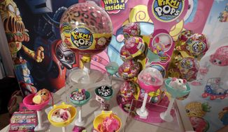 This Tuesday, Sept. 26, 2017, photo shows Pikmi Pops from Moose Toys on display at the 2017 TTPM Holiday Showcase in New York. Some of the hottest toys this year are LOL Surprise and Pikmi Pops. These and similar toys hide small stuffed animals or dolls inside plastic balls that are wrapped in several layers of packaging. Kids peel each layer, revealing tiny bags filled with trinkets, stickers, messages or other doll accessories as they go. (AP Photo/Richard Drew)