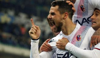 Bologna's Mattia Destro, left, celebrates with teammates after scoring during the Serie A soccer match between Hellas Verona and Bologna, at the Bentegodi stadium in Verona, Italy, Monday, Nov. 20, 2017. (Filippo Venezia/ANSA via AP)