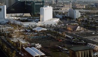 FILE - In this Oct. 3, 2017, file photo, debris litters a festival grounds across the street from the Mandalay Bay resort and casino in Las Vegas. Attorneys who filed one of the first lawsuits after the Oct. 1 mass shooting that killed dozens concert-goers and left hundreds injured on the Las Vegas Strip filed four new negligence cases Monday, Nov. 20, on behalf of more than 450 victims. (AP Photo/Marcio Jose Sanchez, File)