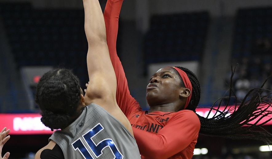 Maryland's Kaila Charles shoots a basket as Connecticut's Gabby Williams, left, defends during the first half an NCAA college basketball game, Sunday, Nov. 19, 2017, in Hartford, Conn. (AP Photo/Jessica Hill) **FILE**