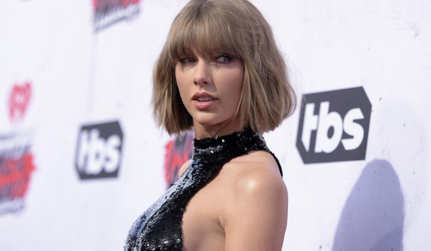 """FILE - In this April 3, 2016, file photo, Taylor Swift arrives at the iHeartRadio Music Awards at The Forum in Inglewood, Calif. Swift's """"reputation"""" is in good standing: the album has sold 1.22 million units in its first week. Nielsen Music and Billboard report Monday, Nov. 20, 2017, that the album is Swift's fourth project to sell more than a million copies in a week. (Photo by Richard Shotwell/Invision/AP, File)"""