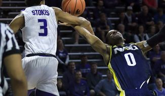 Northern Arizona guard Torry Johnson (0) is fouled by Kansas State guard Kamau Stokes (3) during the first half of an NCAA college basketball game in Manhattan, Kan., Monday, Nov. 20, 2017. (AP Photo/Orlin Wagner)