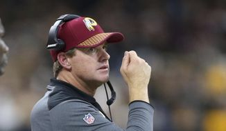 Washington Redskins head coach Jay Gruden watches from the sideline in the first half of an NFL football game against the New Orleans Saints in New Orleans, Sunday, Nov. 19, 2017. (AP Photo/Rusty Costanza) **FILE**