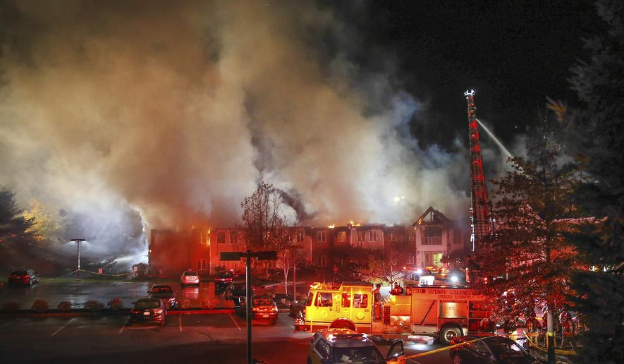 In this Thursday, Nov. 16, 2017 photo, fire fighters battle a blaze at the Barclay Friends Senior Living Community in West Chester, Pa. At least 20 people were injured in the massive fire at the senior living community about 35 miles west of Philadelphia.  (Steven M. Falk/The Philadelphia Inquirer via AP)