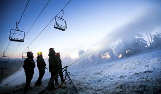 In this Oct. 17 2017 photo provided by Killington Resort, snow-making guns spray snow onto a ski slope in Killington, Vt. For a second year in a row, the women's FIS Alpine Skiing World Cup is returning to Killington with slalom and giant slalom races on Thanksgiving weekend. (Chandler Burgess/Killington Resort via AP)
