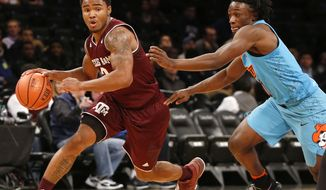 Texas A&M guard T.J. Starks, left, drives downcourt as Oklahoma State guard Brandon Averette pursues during the first half of Game 1 of the Legends Classic NCAA college basketball tournament, Monday, Nov. 20, 2017, in New York. (AP Photo/Kathy Willens)