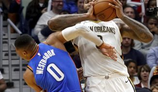 New Orleans Pelicans center DeMarcus Cousins (0) elbows Oklahoma City Thunder guard Russell Westbrook (0) in the head, drawing an ejection from the game, in the second half of an NBA basketball game in New Orleans, Monday, Nov. 20, 2017. (AP Photo/Scott Threlkeld)