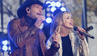 "Tim McGraw and Faith Hill perform on NBC's ""Today"" show at Rockefeller Plaza on Friday, Nov. 17, 2017, in New York. (Photo by Charles Sykes/Invision/AP)"