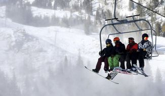 In this Nov. 25, 2016, photo, skiers and snowboarders ride the lift during opening day at Brighton Resort, in Brighton, Utah. Utah ski officials kick off the new season energized by the growing possibility of another Winter Olympics bid and buoyed by two straight seasons of record visitation. (Laura Seitz/The Deseret News via AP)