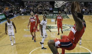Washington Wizards' Bradley Beal dunks during the first half of an NBA basketball game against the Milwaukee Bucks Monday, Nov. 20, 2017, in Milwaukee. (AP Photo/Morry Gash)