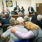 "Nebraska landowner Diana Steskal rests her head on her husband Byron's shoulder as Nebraska Public Service Commissioners leave after their vote approving the TransCanada's Keystone XL pipeline ""mainline alternative route"" on Monday. (Associated PRess)"