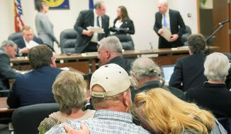 "Diana Steskal rests her head on her husband Byron's shoulder as Nebraska Public Service Commissioners rise to leave following their vote approving the TransCanada's Keystone XL pipeline ""mainline alternative route"" through the state Monday, Nov. 20, 2017, in Lincoln, Neb. The couple are landowners in the path of the pipeline. (Eric Gregory/The Journal-Star via AP) ** FILE **"