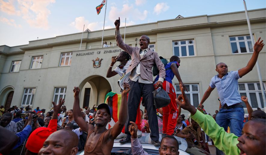 Zimbabweans took to the streets of the capital of Harare after learning that embattled President Robert Mugabe, who ruled the country for 37 years, would step down shortly after the nation's parliament had initiated impeachment proceedings against him. (Associated Press)