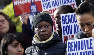 Immigration advocates rally in New York on Tuesday, Nov. 21, 2017, to protest the decision from the Department of Homeland Security to terminate Temporary Protected Status for people from Haiti. The Homeland Security Department said conditions in Haiti have improved significantly, so the benefit will be extended until July 2019 to give Haitians time to prepare to return home. (AP Photo/Mark Lennihan)